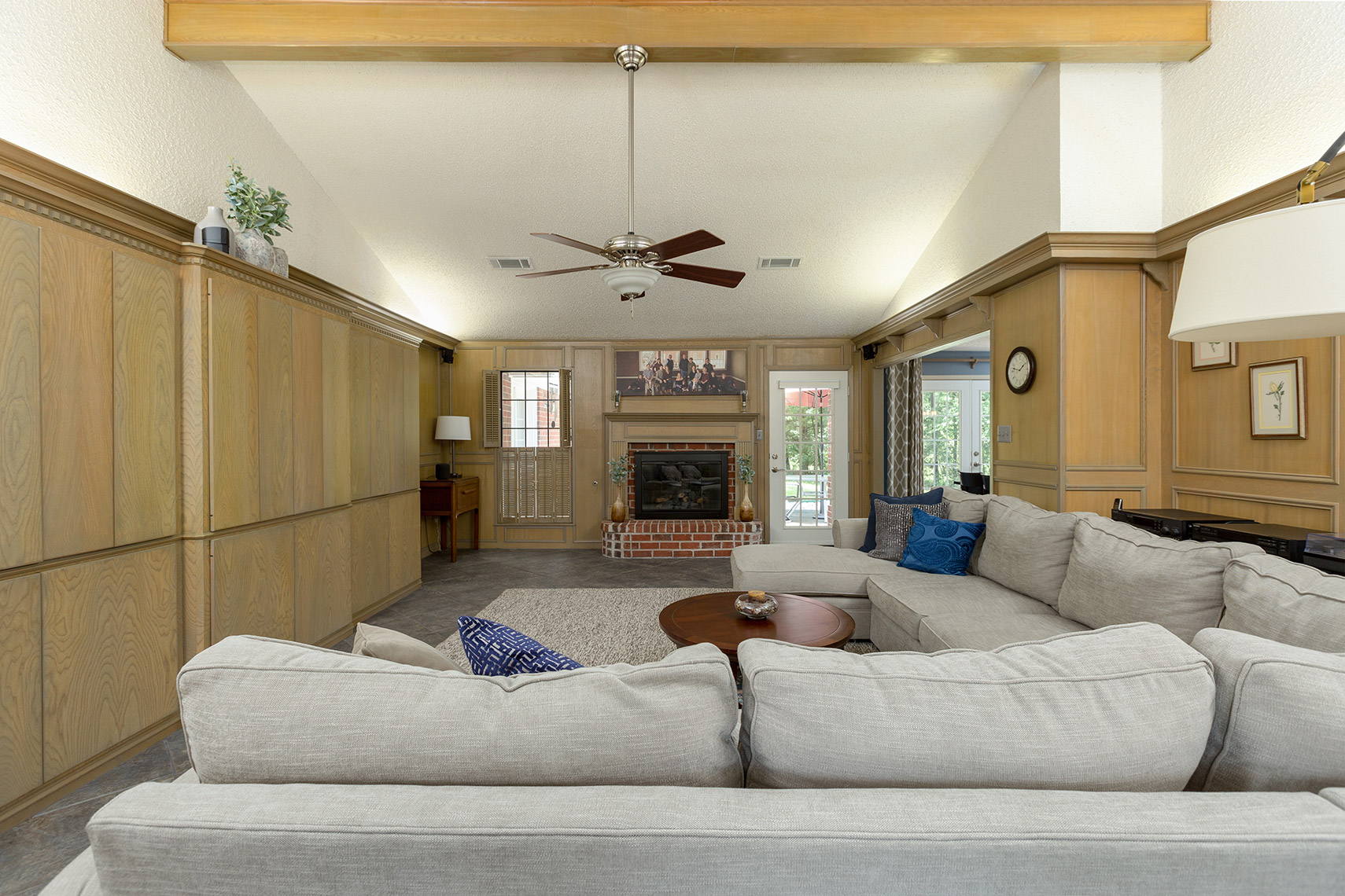 Living-room-with-custom-wood-cabinets-and-paneling