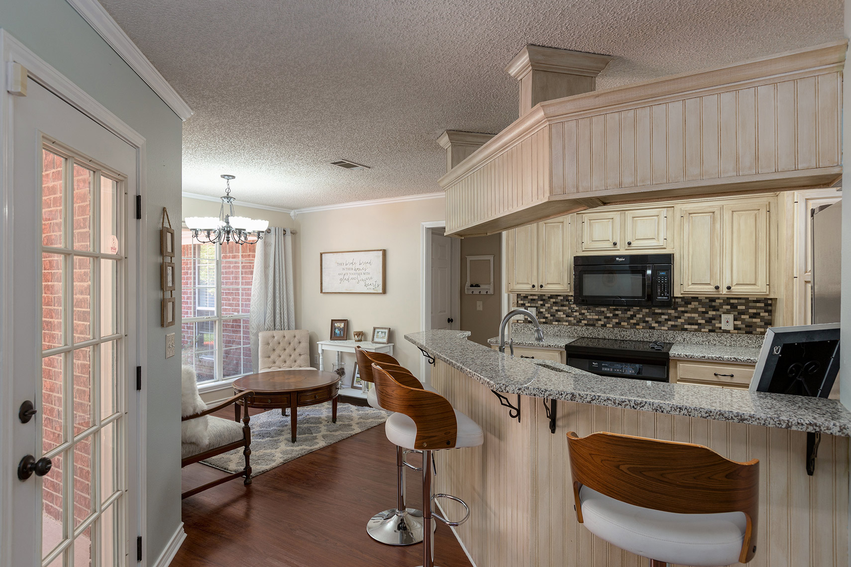 Kitchen-bar-area-flowing-into-a-sunroom